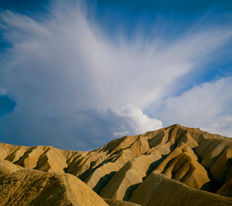 Anvil Cloud Over Badlands, Death Valley National Park, Mojave Desert, California, copyright 1975 Philip Hyde. A Drylands image. Philip Hyde was aided in image selection for Drylands by Jim and Carolyn Robertson of Yolla Bolly Press, who packaged the book for publishing by Harcort, Brace, Jovanovich. Yolla Bolly also packaged Galen Rowell's famous book Mountain Light. The Yolla Bolly archive with Drylands and Mountain Light now resides at Stanford University.