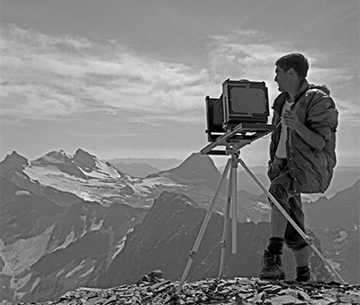 Ed Cooper, author and photographer, working with a newly acquired 5x7 Gundlach Bundschu view camera, top of Mt. Reynolds, Glacier National Park, Washington, copyright Ed Cooper Collection 1964.