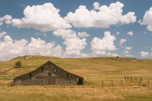 Horst Barn With Cumulus Clouds, Potter, Nebraska copyright 2015 David Leland Hyde. This is a Western style barn in Western Nebraska. More round barns occur in Eastern Nebraska.